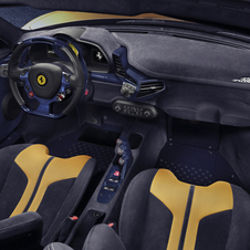 The cockpit has a racing inspired look