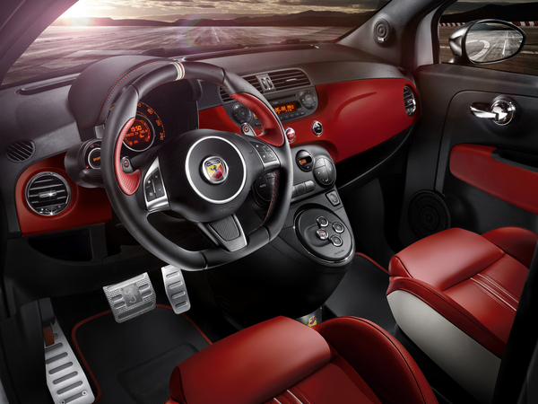 The interior is covered in red leather with white accents and red stitching