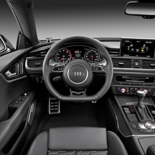 The interior includes a flat-bottom steering wheel